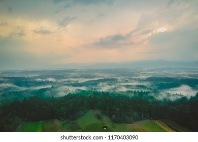 Aerial drone view of White carniola (Bela krajina) region in Slovenia, misty forest after a rain with fog or mist clouds dwelling between trees. Mystical panorama. - Shutterstock ID 1170403090