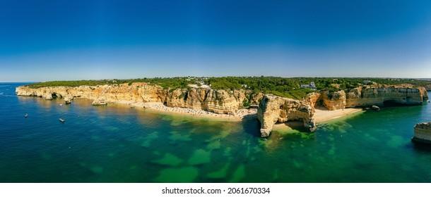 Aerial drone views of Praia da Marinha and Malhada do Baraco - beaches in Algarve, Portugal