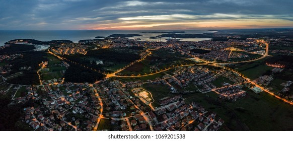 Aerial dusk shot of Pula,Croatia. Known for its multitude of ancient Roman buildings, the most famous of which is the Pula Arena, one of the best preserved Roman amphitheaters, and its beautiful sea.