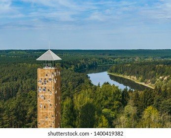 Aerial early spring view of Birstonas new tourist observation tower being constructed near Nemunas river loops surrounded by forest in Lithuania