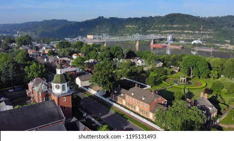 An aerial establishing shot of the small Pennsylvania town of Ambridge, Beaver County. Ohio River in the distance, small church in the foreground. Pittsburgh suburbs.