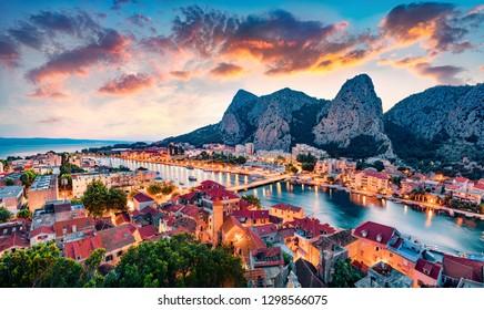 Aerial evening cityscape of old croatian resort - Omis town. Fantastic summer seascape of Adriatic sea, Dalmatia coast, Croatia, Europe. Beautiful world of Mediterranean countries.