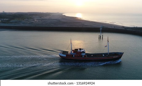 Aerial evening photoof trawler sailing out this commercial vessel is designed to operate trawls which is method of fishing that involves actively dragging or pulling trawl through the water behind