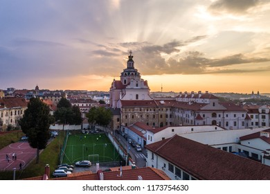 Aerial evening view of Church of St. Casimir and sport facilities in Vilnius old town, Lithuania
