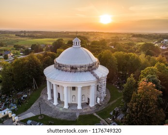 Aerial evening view of circular plan Holy Trinity Church in Suderve, Vilnius district, Lithuania