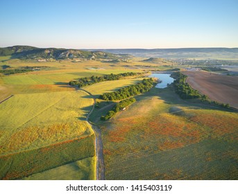 Aerial fields and meadow in mountain. Beautiful country area. Nature landscape.