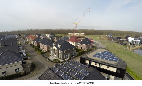 Aerial flight bird view over urban area new modern build houses with solar panels sun panels on roofs providing renewable energy by sunlight great new architecture new neighborhood 4k resolution