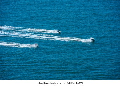 Aerial flying view of jet ski riding in Normandie, France, Europe