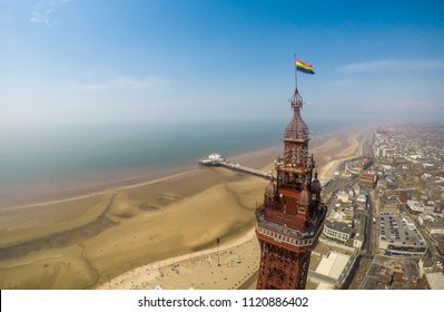 Aerial footage, drone, of the famous Blackpool Tower and beach from the sky on a beautiful Summers day on one of Great Britains most popular holiday destinations