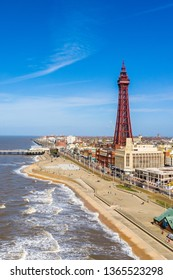 Aerial footage, drone view , of the famous Blackpool Tower and beach from the sky on a beautiful Summers day on one of Great Britains most popular holiday destinations, tourist attractions by the sea