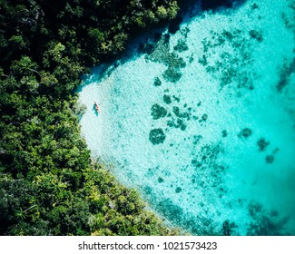Aerial footage of a kayak exploring a tropical paradise