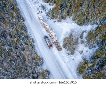 Aerial Of Forestry Logging Truck Loading Freshly Cut Logs - Northern Ontario Canada