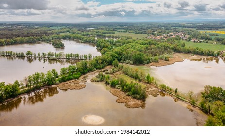 Aerial fresh spring landscape. Stunning view of fishpond systems, meadows,cycle paths,and fairytale countryside in south Bohemia, Czechia.Top view of beautiful nature, Drone photography from above.