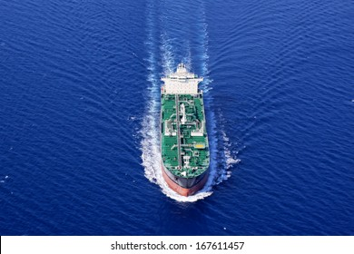 Aerial front side view of oil tanker ship sailing on open sea