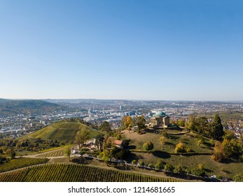 Aerial of the Grave Chapel (Grabkapelle) on Rotenberg and surrounding industrial area with museums and soccer stadium in Stuttgart, Germany