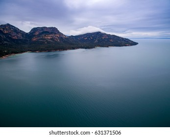 Aerial of The Hazards mountain range in Coles Bay, Freycinet National Park, Tasmania, Australia.
