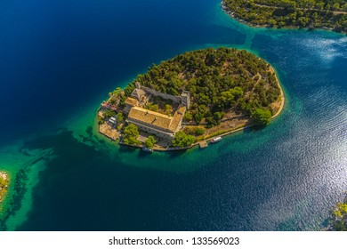 Aerial helicopter shoot of National park on island Mljet, Dubrovnik archipelago, Croatia. The oldest pine forest in Europe preserved and Monastery of Saint Mary on a small island in a big lake.