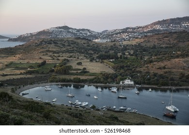 Aerial high angle view of  Gumusluk bay, Bodrum. Gumusluk, a seaside village and fishing port in Turkey, is situated on the remains of the ancient city of Myndos