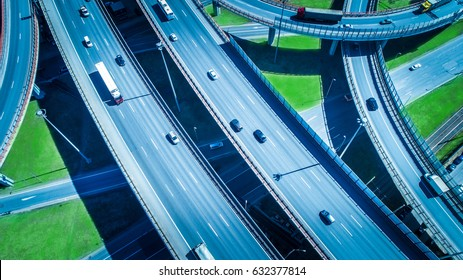 Aerial highway junction. Busy highway from aerial view. Highway shape like number 8 and infinity sign. Urban highway and lifestyle concept.