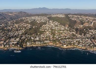 Aerial of hillside ocean view homes in the Laguna Beach neighborhood of Orange County, California.
