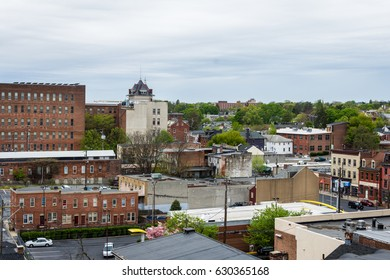 Aerial of historic downtown Lancaster, Pennsylvania with blooming trees
