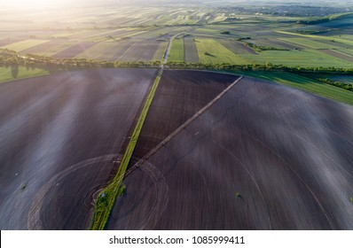 Aerial image of agricultural field with center pivot irrigation systems forming round shape field, shoot from drone