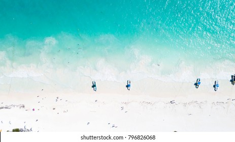 An aerial image of a beautiful blue beach in Cancun, Mexico.