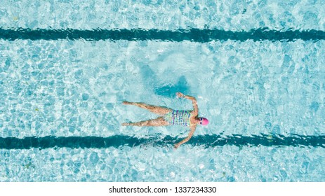 Aerial image of a beautiful female swimmer in a swimming pool getting ready to train.
