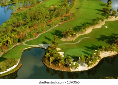 aerial image of beautiful Florida west coast golf course and green, surrounded by water and sand hazard features