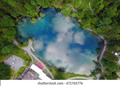 Aerial image of Blausee (Blue Lake) a small mountain lake in Kander Valley in Bernese Oberland, Switzerland