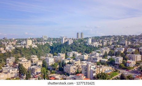 Aerial image of the city of Haifa, Israel, above and over the slopes of Mount Carmel.