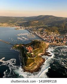aerial image of the coastal city of baiona in pontevedra, galicia