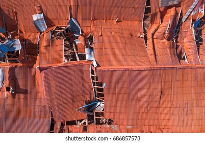 Aerial image of a completely ruined roof after a severe storm