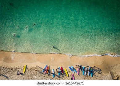 Aerial Image of cornish beach with Paddle boards lined up