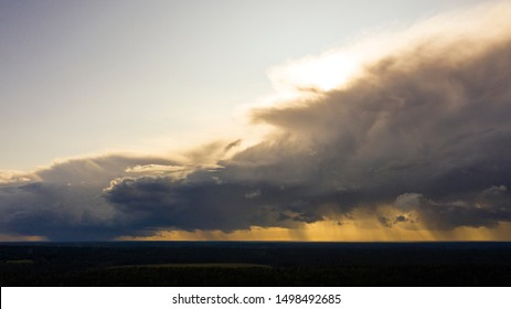 Aerial image of dark Storm clouds over the land. Aerial panorama of storm clouds. Panorama of thunder clouds. View from drone. Aerial bird's eye view. Aerial top view cloudscape. Texture of clouds.