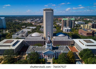 Aerial image of the Florida State Capitol historical building with flags