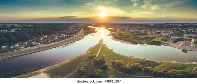 Aerial image of Kaunas city, Lithuania. Summer sunset scene. Confluence of two rivers (Namunas and Neris)