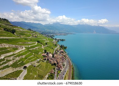 Aerial image of Lavaux vineyards in Switzerland featuring the charming village of Saint Saphorin.