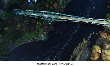 Aerial image looking down on the David Livingstone memorial bridge at Blantyre, above the dark waters of the River Clyde.