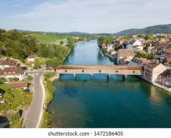 Aerial image the old wooden covered bridge over the Rhine river, which connects the Swiss old town Diessenhofen and German town Gailingen.