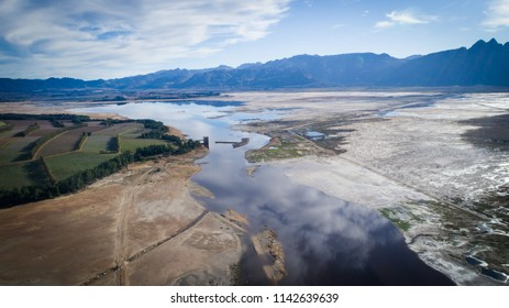 Aerial image over a very dry Theewaterskloof dam during the worst drought in decades in the Western Cape of South Africa with massive patches of barren earth exposed