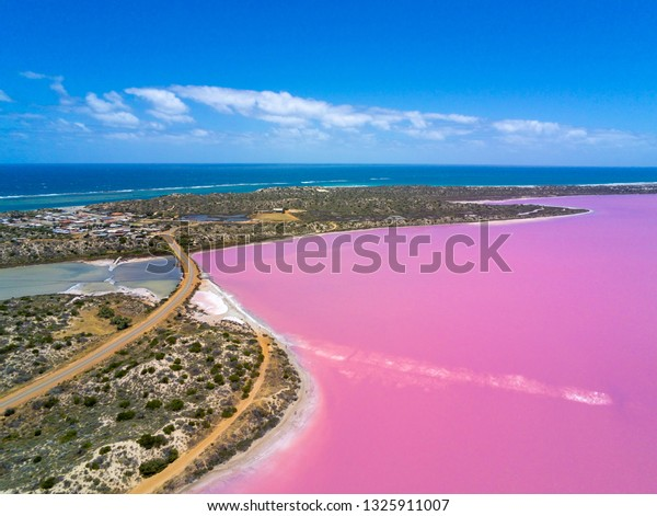 Aerial image of the Pink Lake and Gregory in Western Australia with Indian Ocean in the background