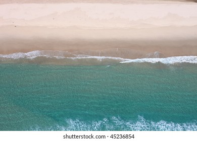 Aerial image of pristine ocean and sandy beach.  Perspective is straight down.