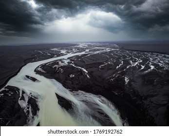 Aerial image of river patterns and dramtic clouds in Iceland