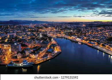 Aerial image of Stavanger city, Norway. This image of Stavanger was taken during sunset in December 2018. The bay is called Vagen.