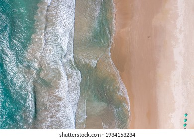 Aerial images showing the sand, waves and blue sea of Porto de Galinhas beach, in Pernambuco.