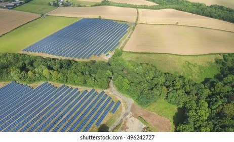 Aerial industrial view Photovoltaic solar panels on a Renewable Energy Solar plant in the Countryside