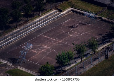 an aerial iphoto of a grunge basketball court in not very good condition with a small steps at the side