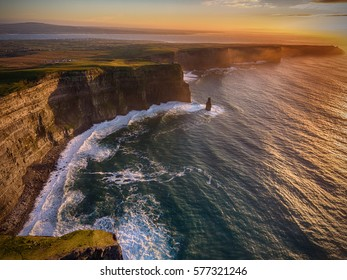 Aerial Ireland countryside tourist attraction in County Clare. The Cliffs of Moher sunset and castle Ireland. Epic Irish Landscape along the wild atlantic way. European Atlantic Geotourism Route