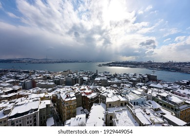 Aerial Istanbul winter panorama from Galata Tower, with Bosphorus, Halic and snowy roofs. Istanbul, Turkey